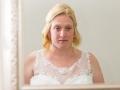 Bride looks into mirror, Paul & Faye - Wedding Photographer Bishop Auckland, North East