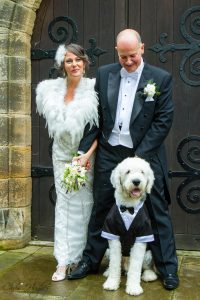 Bride & Groom & Pet at the wedding of John & Gill at St James Church, Bishop Auckland
