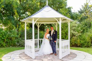 The Bride and Groom in the wedding gazebo, Manor House Hotel, West Auckland